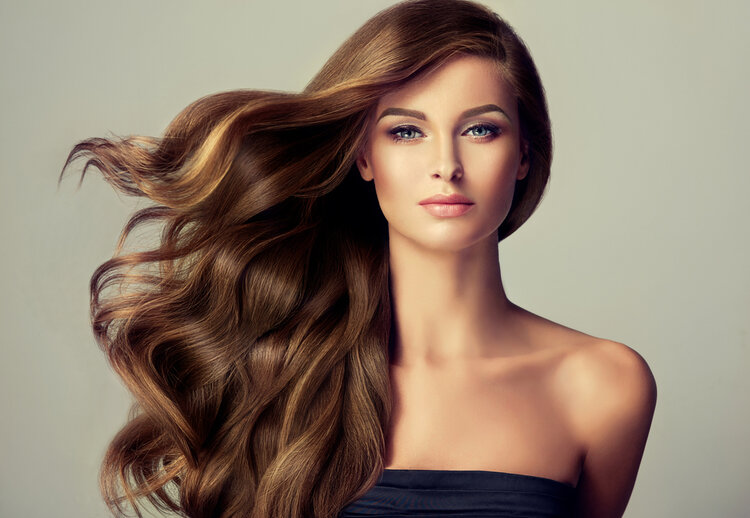 girl with long brown hair and green eyes
